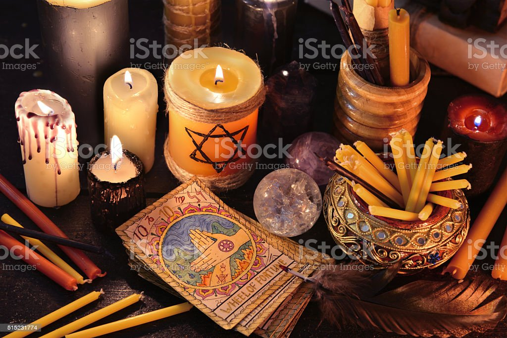 Magic objects, candles and the tarot cards stock photo