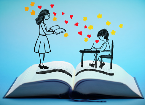 the drawings of a teacher and her pupil in a classroom pop up from an open book, with some sparkling magic and love
