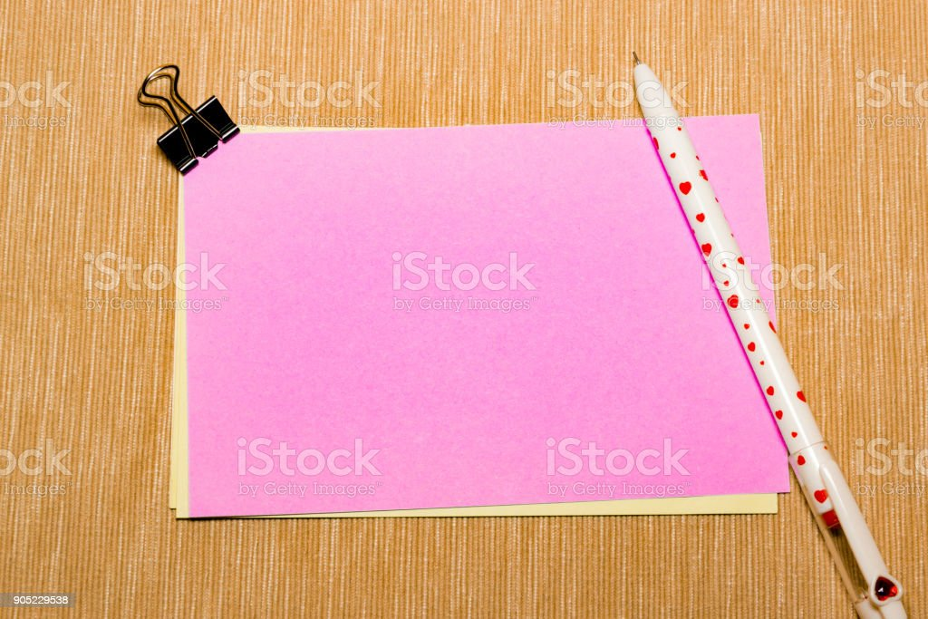 magic pen and paper note and paperclip on yellow background, minimal concept and similarities differences stock photo