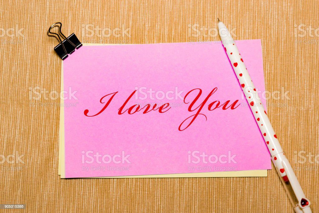 magic pen and paper note and paperclip on yellow background, minimal concept and similarities differences. I love you. stock photo