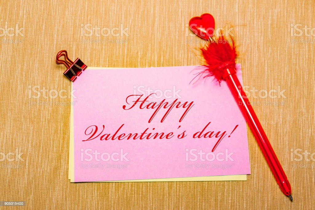 magic pen and paper note and paperclip on yellow background, minimal concept and similarities differences. Happy Valentine s day. stock photo