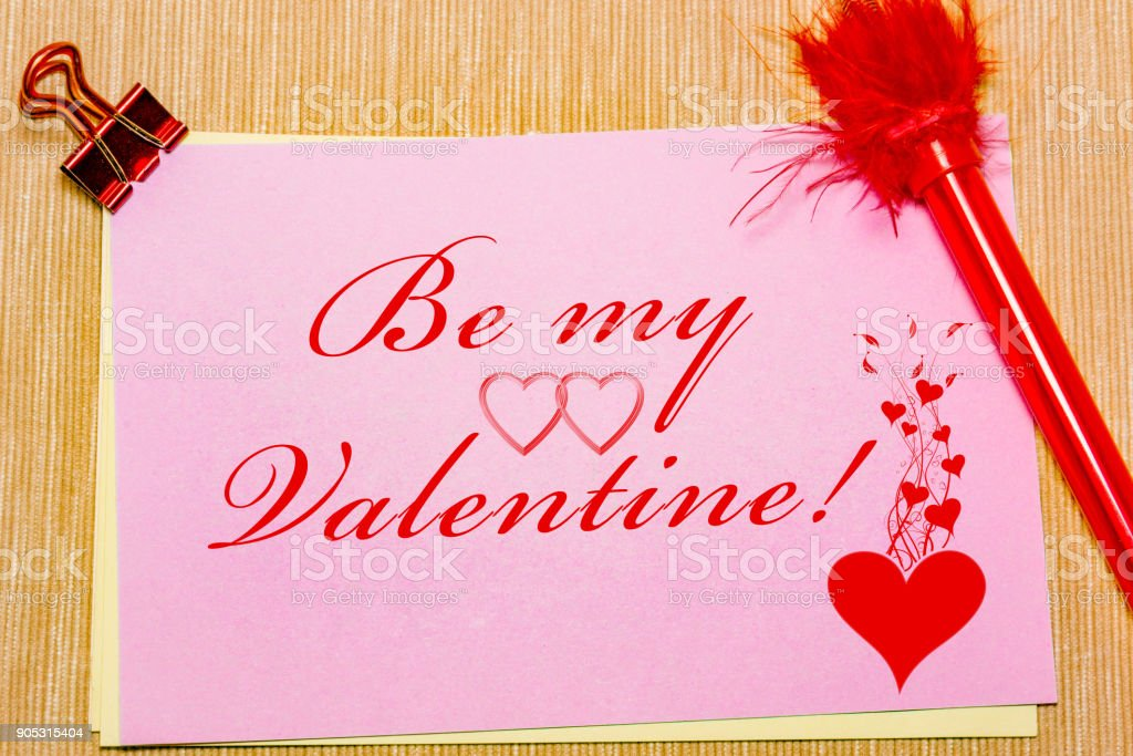 magic pen and paper note and paperclip on yellow background, minimal concept and similarities differences. Be my Valentine. stock photo