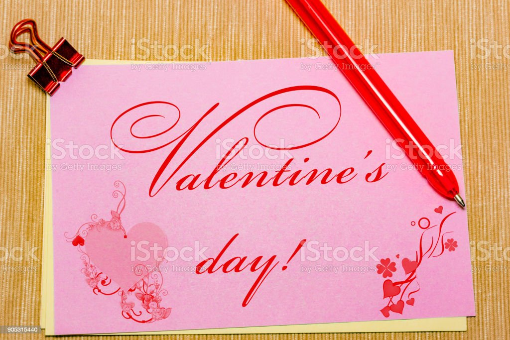 magic pen and paper note and paperclip on yellow background, minimal concept and similarities differences. Valentine s day. stock photo
