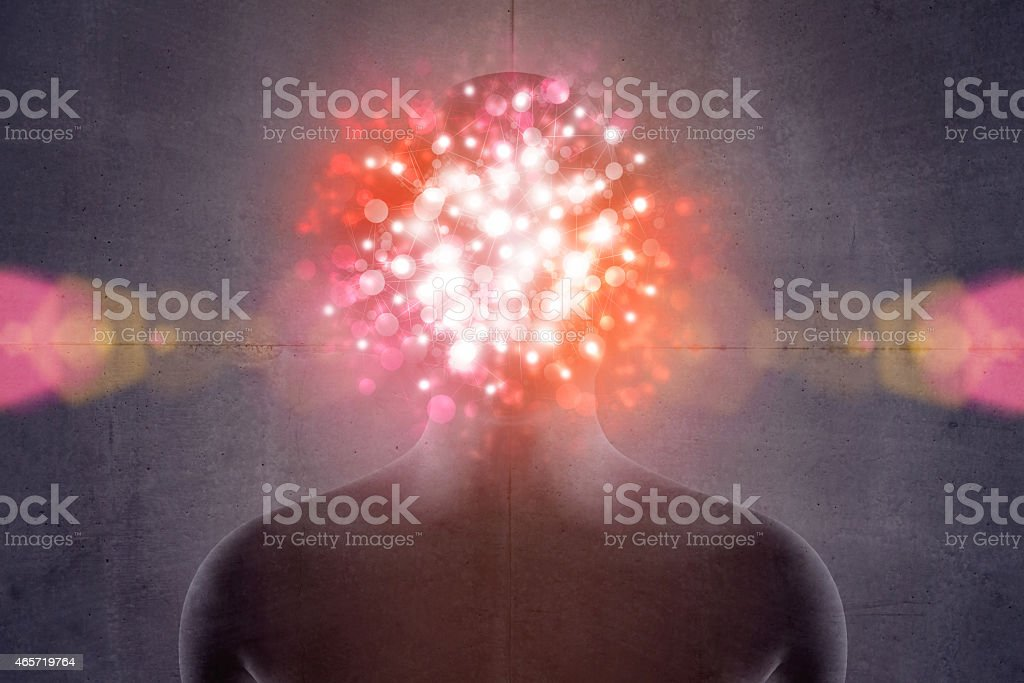 Magic personality: human head with light explosion hiding face stock photo