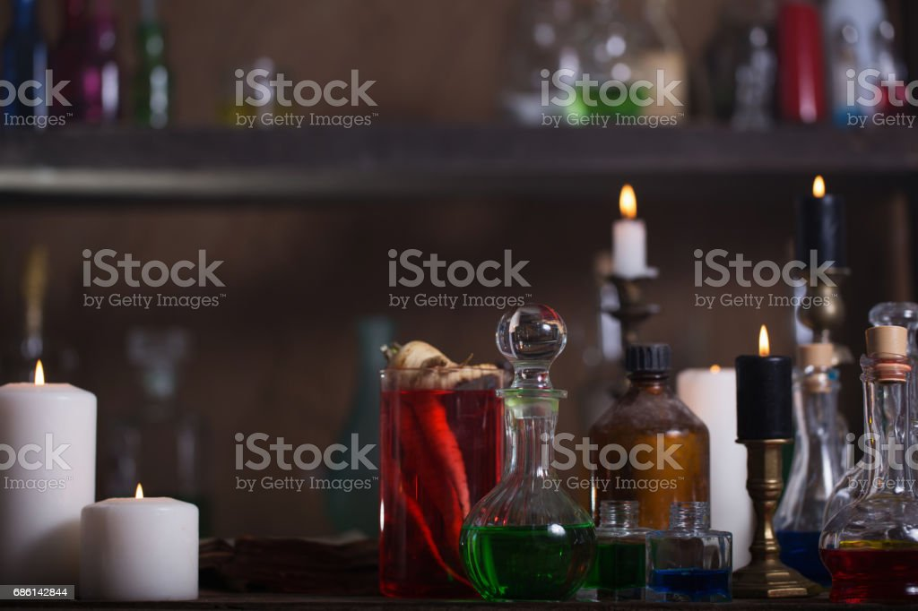 Magic Potion Ancient Books And Candles Stock Photo - Download Image Now