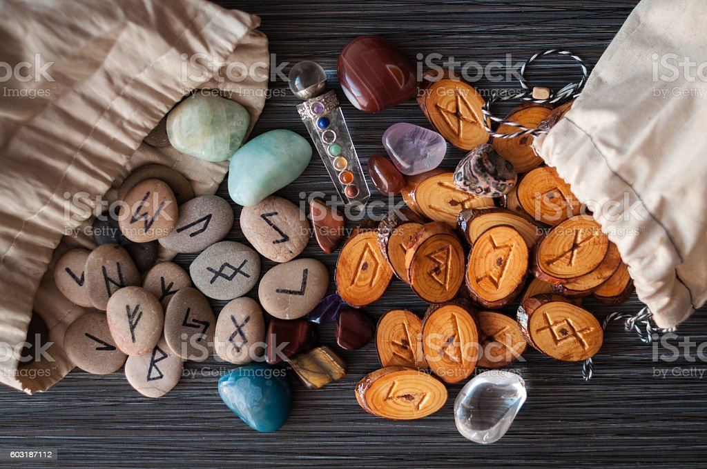 magic runes with their hands stock photo