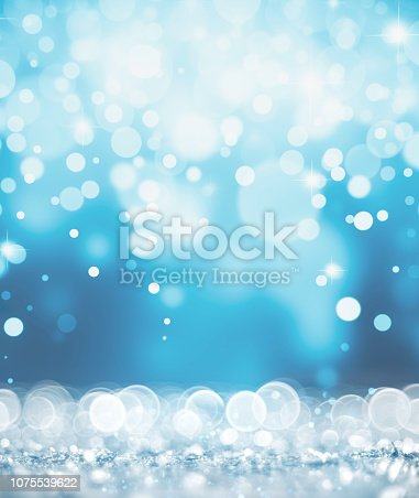 872229066 istock photo Magic silver and blue glitter 1075539622