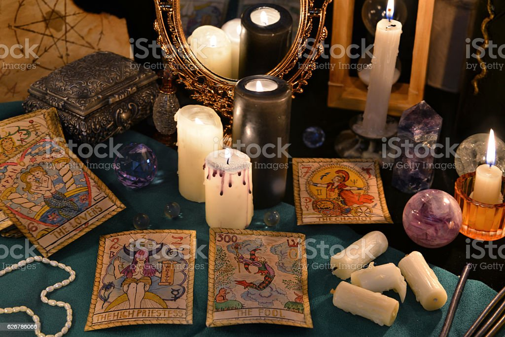 Magic still life with crystals, the Tarot cards and candles stock photo