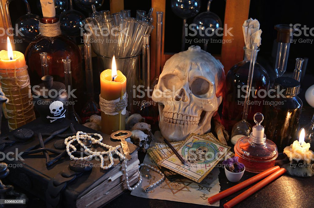 Magic still life with tarot cards, skull and burning candles stock photo