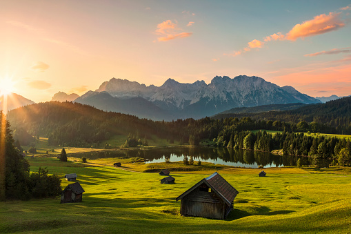 Magic Sunrise at Alpine Lake Geroldsee - view to mount Karwendel, Garmisch Partenkirchen, Alps