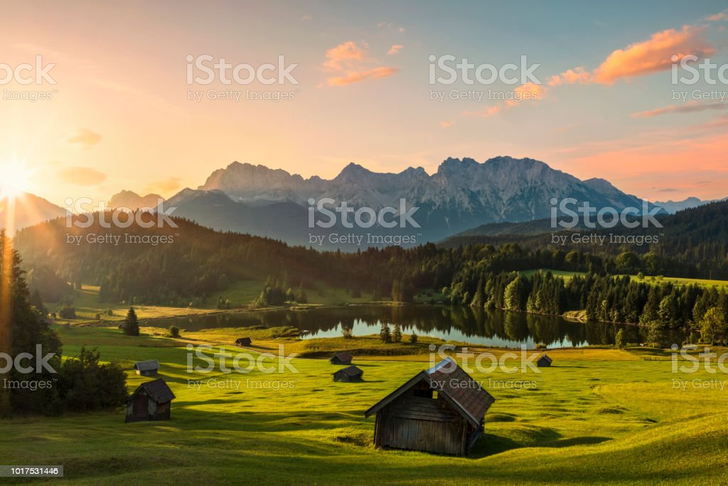 Magic Sunrise at Alpine Lake Geroldsee - view to mount Karwendel, Garmisch Partenkirchen, Alps stock photo