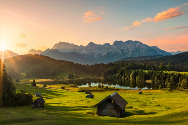 magic sunrise at alpine lake geroldsee - view to mount karwendel, garmisch partenkirchen, alps - german culture stock pictures, royalty-free photos & images
