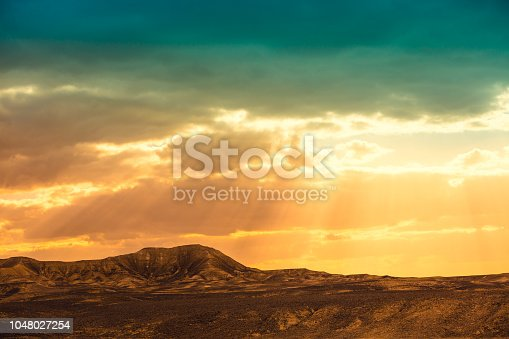 Magic sunset over the mountain in Negev desert, wild nature Israel