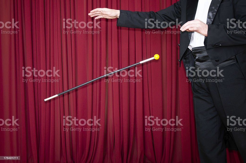 Magic trick with dancing cane stock photo