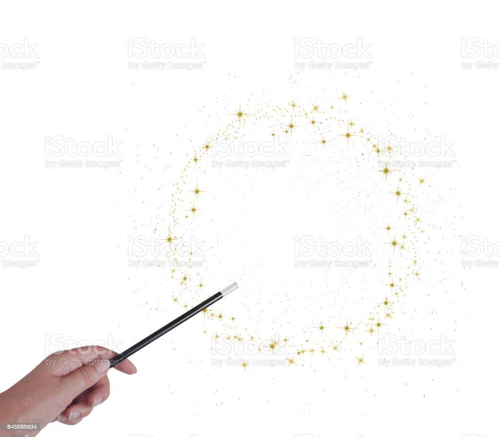 Baguette magique en main, cercle ou anneau d'étoiles dorées et stardust isoated sur blanc. - Photo