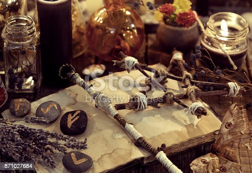 811119304 istock photo Magic wand, pentagram, lavender bunch, moth and runes, toned image 871027684