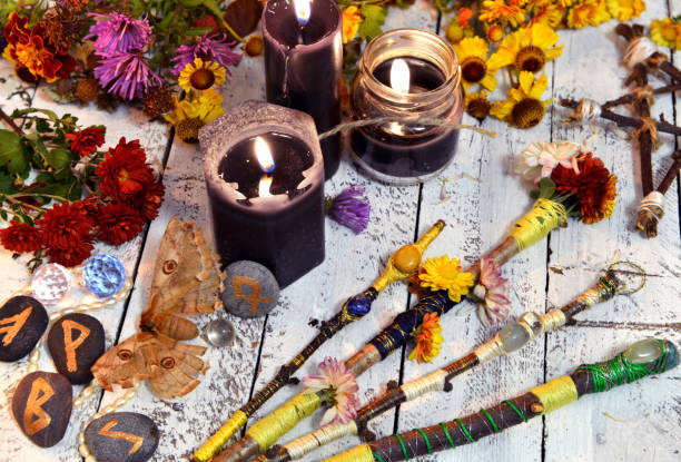 Magic Wands Black Candles Flowers And Moth Death Symbol Stock Photo