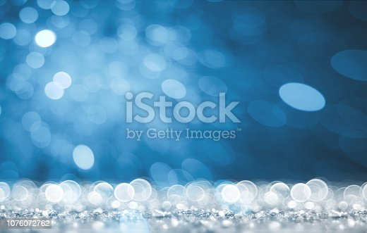 872229066 istock photo Magic white and blue glitter 1076072762