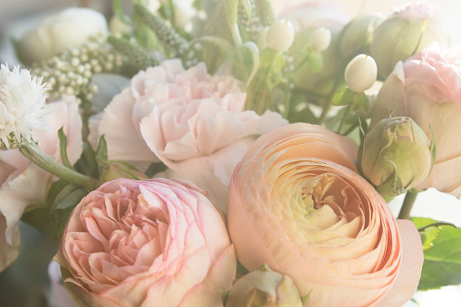 roses, carnations and lots and lots of little flowers, fresh fragrance, pastel tone. it's just beautiful