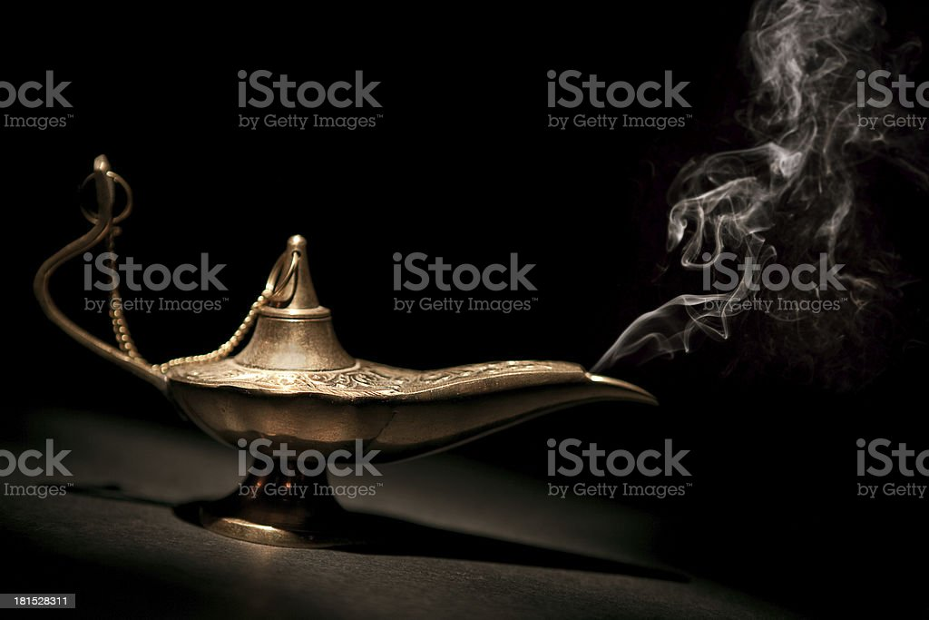 Magical Geni Lamp with Smoke and black background stock photo