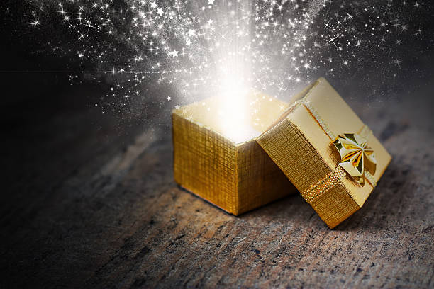 Magical gift with rays and sparks stock photo
