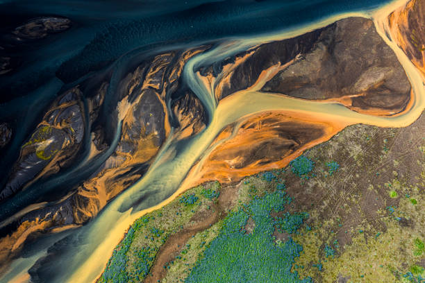 Magical helicopter view of Iceland glacial rivers stock photo