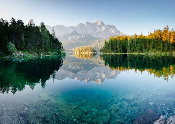 Magical image of the famous lake Eibsee. Location resort Garmisch-Partenkirchen, Bavarian alp, sightseeing Europe.