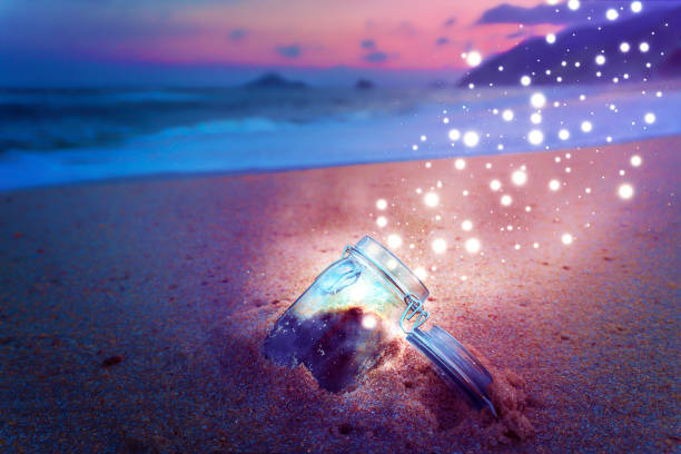 Magical Jar Open On Beach at Night Releasing Star Dust Creative Concept stock photo