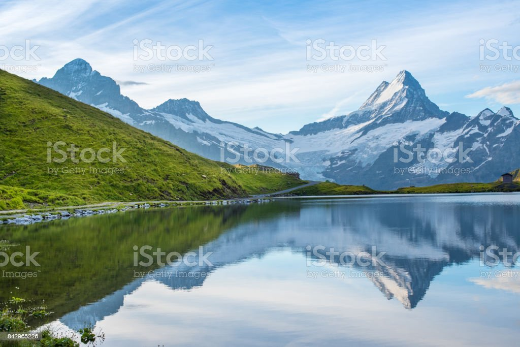 A magical landscape with a lake in the mountains in the Swiss Alps, Europe. Wetterhorn, Schreckhorn, Finsteraarhorn et Bachsee. ( relaxation, harmony, anti-stress - concept). stock photo