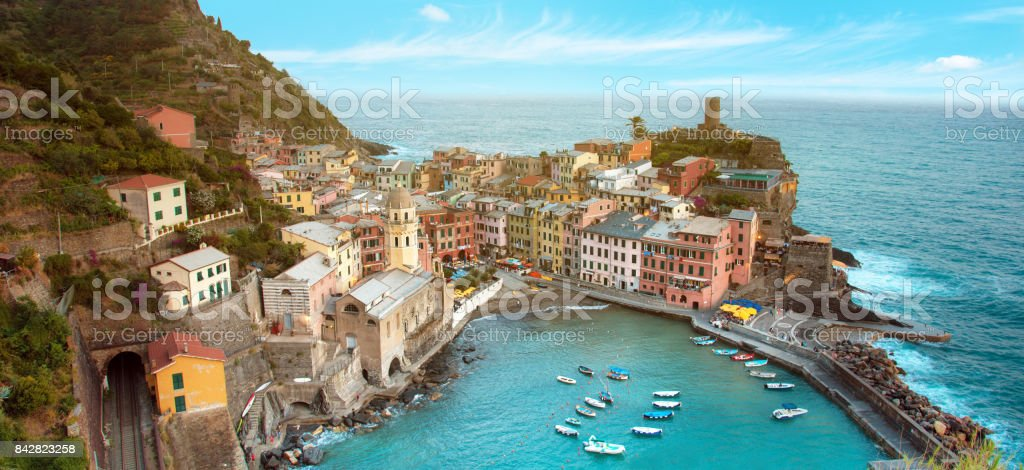 Magical landscape with boats in the bay and colored houses on the rock in Vernazza, Cinque Terre, Italy, Europe on sunny day stock photo