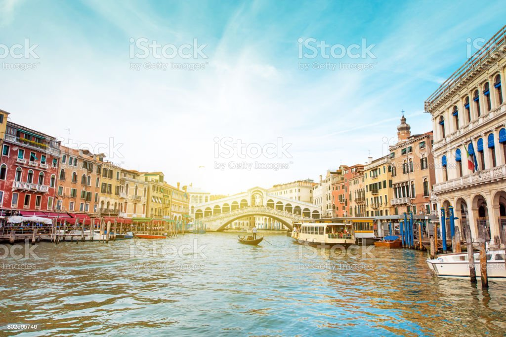 A magical landscape with gondola on the Grand Canal on a sunny day in Venice, Italy, Europe. (Romantic travel, honeymoon - concept) stock photo