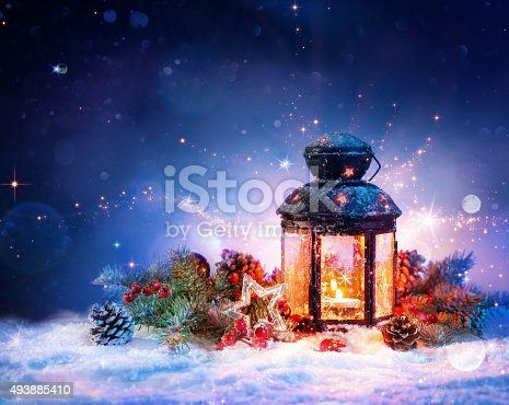 865140324 istock photo Magical Lantern On Snow With Christmas Decoration 493885410