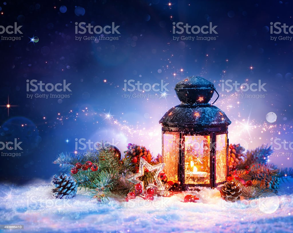 Magical Lantern On Snow With Christmas Decoration stock photo