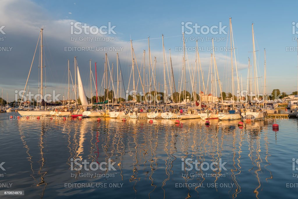 Magical light by sunset in Borgholm harbor in Sweden stock photo