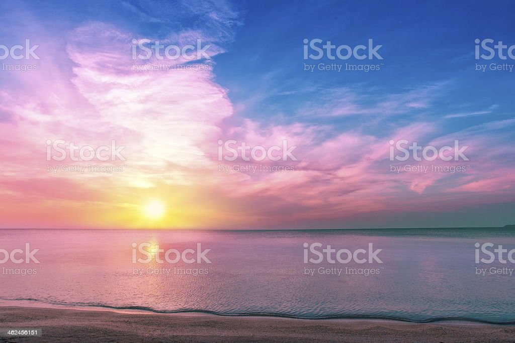 Magical multicolored sunset over the seashore stock photo