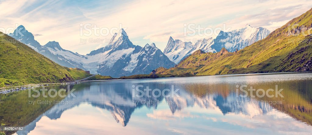 A magical panorama landscape with a lake in the mountains in the Swiss Alps, Europe. Wetterhorn, Schreckhorn, Finsteraarhorn et Bachsee. ( relaxation, harmony, anti-stress - concept). stock photo