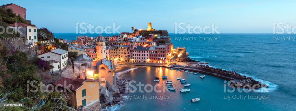 Magical panorama landscape with boats in the bay and colored houses on the rock in Vernazza, Cinque Terre, Italy, Europe stock photo