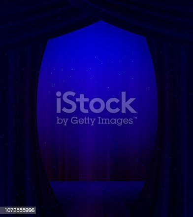 Stage with dark blue curtains and blue light