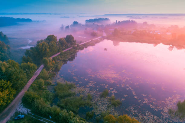magical sunrise over lake. misty morning, rural landscape. aerial view - barragem do roxo imagens e fotografias de stock