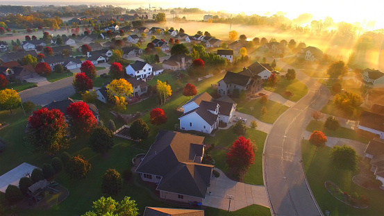Magical sunrise over sleepy, foggy neighborhood