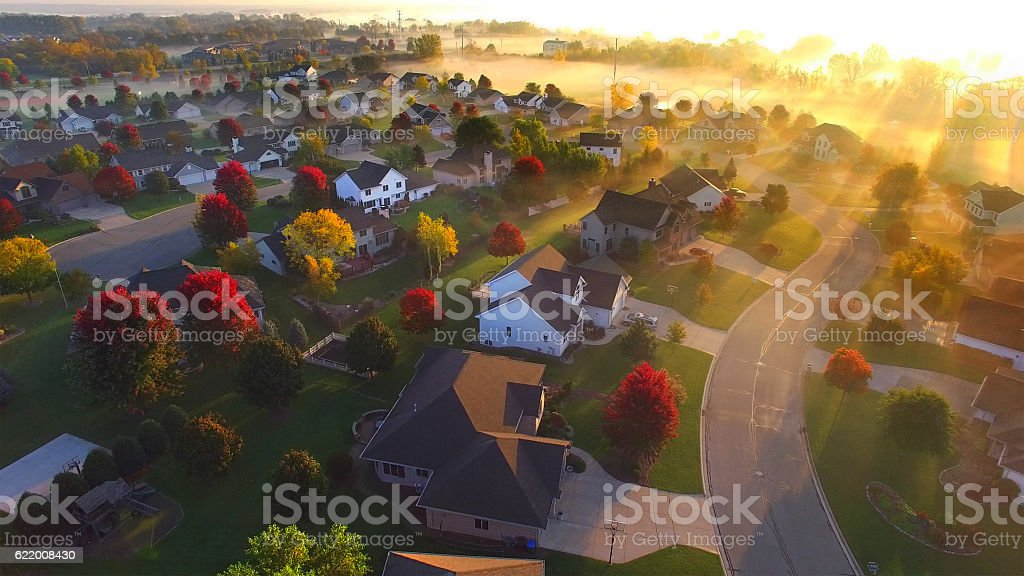 Magical sunrise over sleepy, foggy neighborhood stock photo