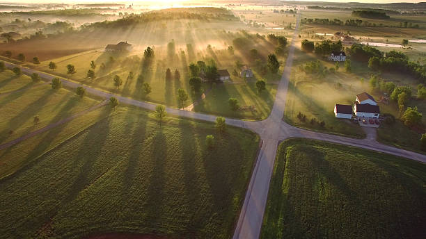Magical sunrise through ground fog with long shadows and sunbeams Magical sunrise through ground fog with long shadows and sunbeams. wisconsin stock pictures, royalty-free photos & images