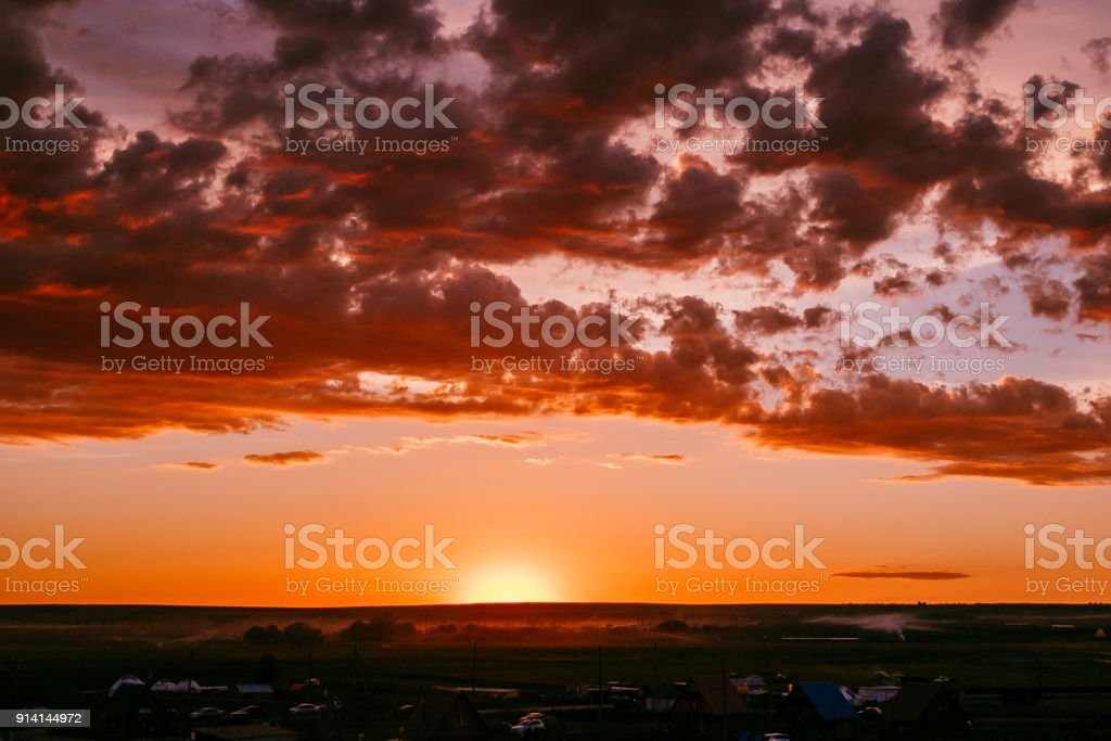 magical sunset, amazing clouds . the ancient settlement of Arkaim stock photo