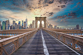 Magical sunset view of the Brooklyn Bridge. Empty bridge with no people during lockdown in New York, USA.