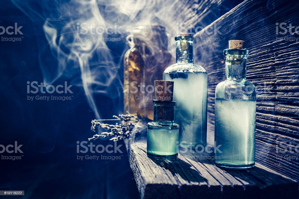 Magical witch lab with blue light and potion for Halloween stock photo