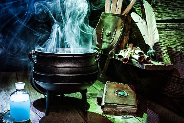 magical witch pot with scrolls and books for halloween - pfannen test stock-fotos und bilder
