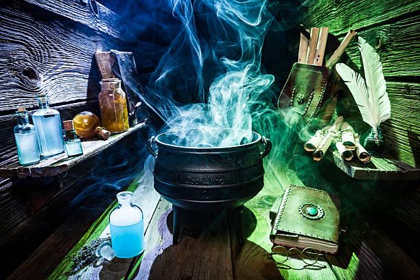 magical witch workshop with blue and green smoke for halloween - pfannen test stock-fotos und bilder