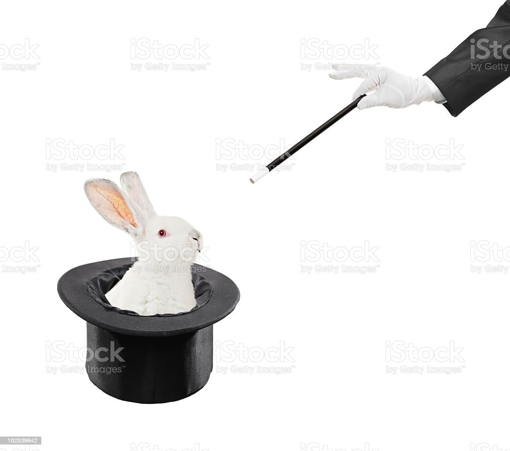 Magician doing the rabbit in the hat trick stock photo
