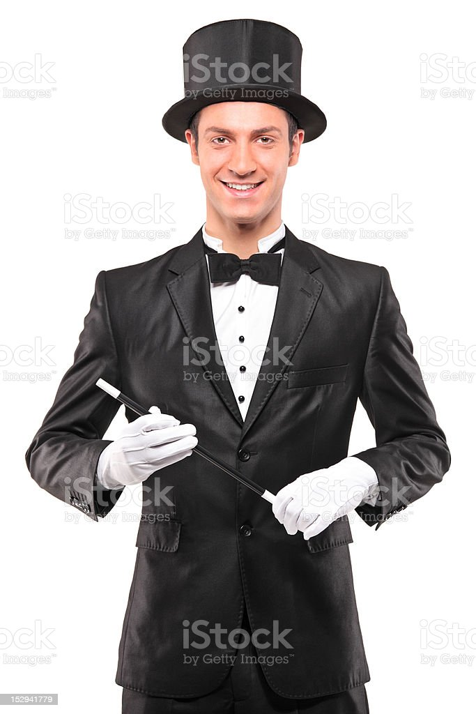 Magician holding a magic wand and posing stock photo