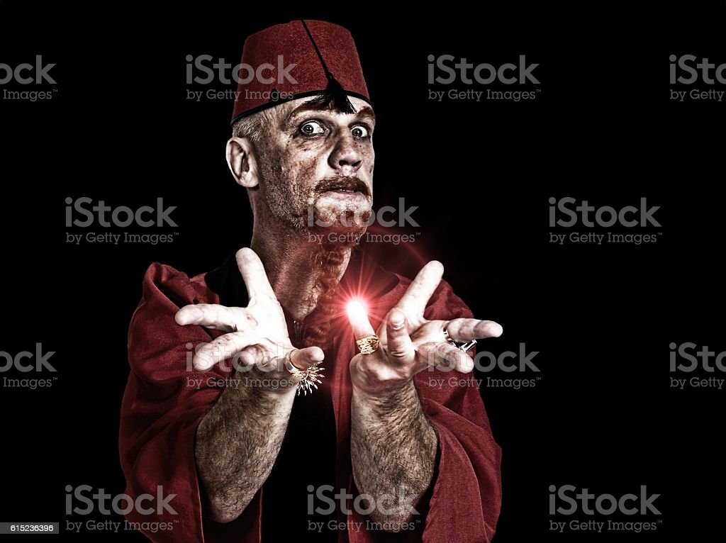 Magician / Hypnotist  staring at camera stock photo